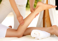 Foot Massage.  Close-up of a Young Woman Getting Spa Treatment. Royalty Free Stock Image