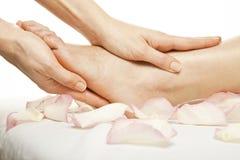 Foot massage female legs Stock Images