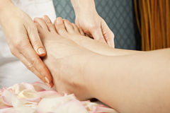 Foot massage female legs Royalty Free Stock Photo