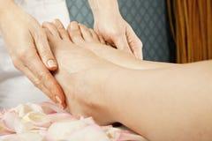 Foot massage female legs royalty free stock photo