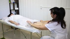 Foot massage. In the patient. The doctor does the massage of the feet, heels and toes on the legs stock video footage