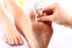 Foot massage, Foot reflexology Stock Image