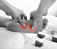 Foot massage. Healthy foot massage, black and white stock image