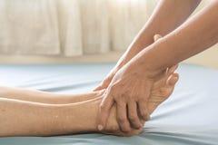 Foot Massage old women stock image