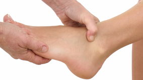 Foot massage isolated on white stock video footage