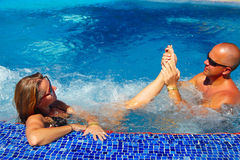 Foot massage in jacuzzi Stock Photo