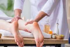 The foot massage in medical spa. Foot massage in medical spa stock image