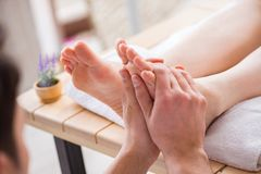 The foot massage in medical spa. Foot massage in medical spa royalty free stock photography