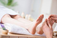 The foot massage in medical spa. Foot massage in medical spa stock photo