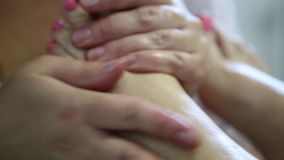 Foot massage. In the patient. The doctor does the massage of the feet, heels and toes on the legs stock video