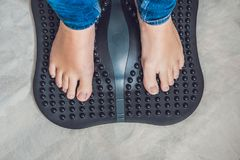 Foot Massage and physiotherapy. Female foot massage device massaged stock image