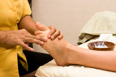Foot massage in spa Royalty Free Stock Image