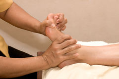 Foot massage in spa Stock Photos
