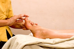 Foot massage in spa Stock Photo