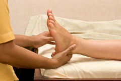 Foot massage in spa Stock Images