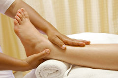 Foot massage, spa foot oil treatment. Stock Image