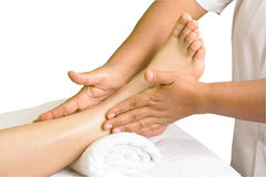 Foot massage, spa foot oil treatment in white background Royalty Free Stock Image