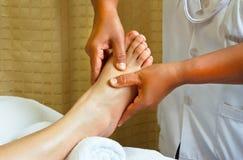 Foot massage, spa foot treatment. Reflexology foot massage, aroma spa foot treatment Royalty Free Stock Photos