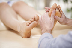 Foot massage at a spa Stock Images