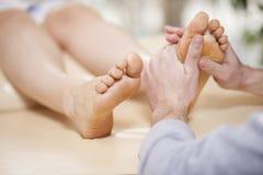 Foot massage at a spa. Giving a foot rub at a healthy and beauty spa Stock Images