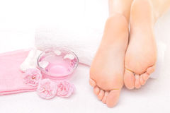 Foot massage in the spa with pink rose Royalty Free Stock Images