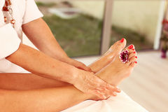 Foot massage in the Spa. Relaxation Royalty Free Stock Photo