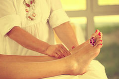 Foot massage in the Spa Royalty Free Stock Photos