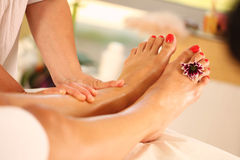 Foot massage in the Spa Stock Photo