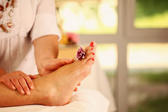 Foot massage in the Spa Stock Images