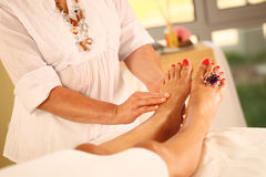 Foot massage in the Spa Stock Photography