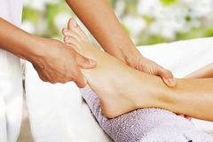 Foot massage in the spa salon. In the garden Royalty Free Stock Photos