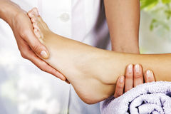 Foot massage in the spa salon. In the garden Royalty Free Stock Images