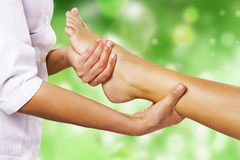 Foot massage in the spa salon. In the garden Royalty Free Stock Image