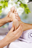 Foot massage in the spa salon. In the garden Stock Photography