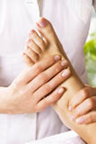 Foot massage in the spa salon royalty free stock photo