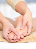 Foot massage in spa salon. Healthy massage for caucasian foot in spa beauty salon - close-up Stock Photography