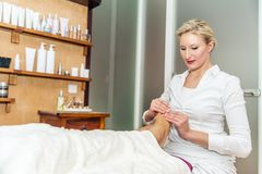 Foot massage in a spa salon Royalty Free Stock Photography
