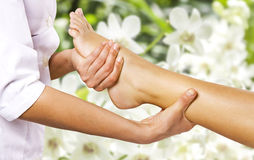 Foot massage in the spa salon. Foot massage in the spa salon in the garden stock photo