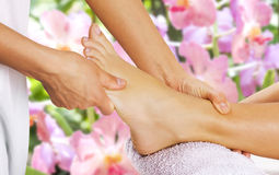 Foot massage in the spa salon. Royalty Free Stock Photo