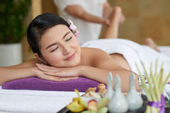 Foot Massage in Spa Salon. Portrait of pretty women savoring moment of tranquility while having foot massage in spa salon royalty free stock photos