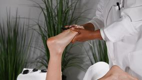 foot massage and stimulation of acupressure points