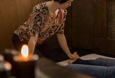 Foot massage in thai studio. Professional therapist giving traditional Thai massage.  Stock Images