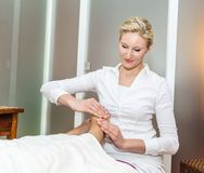 Foot massage by a therapist Stock Images