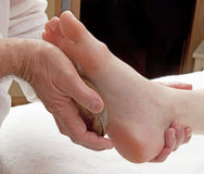 Foot massage for wellbeing Stock Image