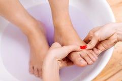 Foot massage Stock Image