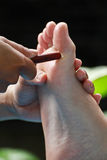Foot massage by wood stick Stock Photography