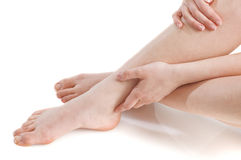 Foot massaging Royalty Free Stock Images