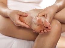 Foot massaging Stock Image