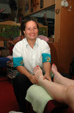 Foot Masseuse at work Phuket Stock Images