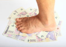 Foot on money - crowns Royalty Free Stock Photo
